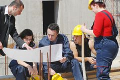 Meeting. Workers looking at construction plans Royalty Free Stock Photography