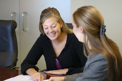 In a meeting. Two women in a meeting Royalty Free Stock Image