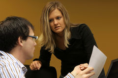 In a meeting. Woman in a meeting discussing project with coworker Stock Photo
