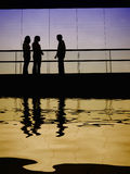 Meeting. Group talking in the building, with water reflection Royalty Free Stock Images
