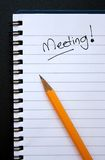 Meeting. Ringed paper notepad with a meeting reminder stock photography