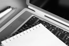 Meeting. Photo of a notebook on a laptop keyboard. Shallow depth of field Royalty Free Stock Image