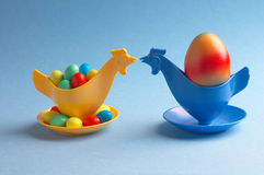 Meeting. Two chicken- eggcups kissing each other Stock Photography