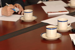 Meeting. Some cup of tea in meeting room Royalty Free Stock Photo