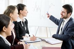 Meeting. Modern young people at a business meeting Stock Images
