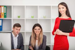 Meeting with agent in office, buying renting apartment or house, buyers of real estate ready to conclude a deal, family couple sh. Aking hands with realtor after royalty free stock image