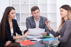 Meeting with agent in office, buying renting apartment or house, buyers of real estate ready to conclude a deal, family couple sh. Aking hands with realtor after stock image