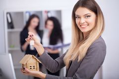 Meeting with agent in office, buying renting apartment or house, buyers of real estate ready to conclude a deal, two women stock image