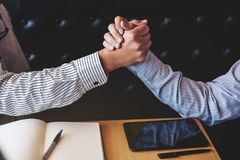 Meeting And Greeting Concept, Two Confident Business Handshake A Royalty Free Stock Image