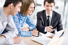Meeting in the bank. Manager talks to a young couple in the bank Royalty Free Stock Photos