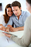 Meeting with banker for project. Young couple meeting financial adviser Royalty Free Stock Images
