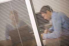 Meeting behind venetian blind Stock Photos