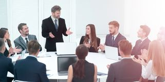 Business group greets leader with clapping and smiling Stock Photos