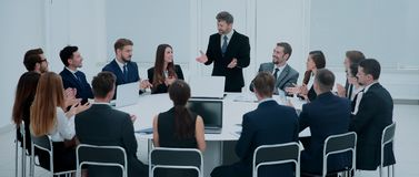Business group greets leader with clapping and smiling Royalty Free Stock Photos