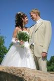 Meeting on bridge. Bridegroom and bride stand on bridge Stock Images