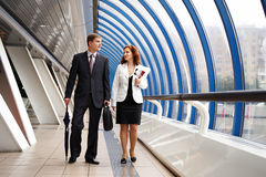 Meeting of business partners. Business meeting, men and women in the interiors of trade center Stock Photos