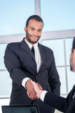 Meeting business partners. African businessman shaking hands Stock Photo