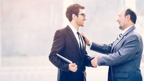 Meeting of business partners with a handshake against the background of team work stock photos