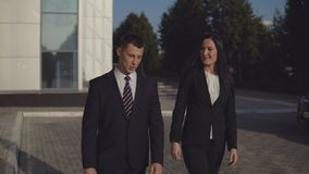 Business people while working near office building stock footage