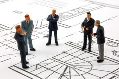 Meeting of businessman on architecture plan royalty free stock images