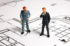 Meeting of businessman on architecture plan. Meeting of business man on architecture background Stock Photos