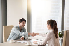 Meeting of businessman and businesswoman shaking hands in the of royalty free stock photos