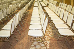 Meeting chair. Stainless steel, leather armchairs arranged in a mess. A straight line For use in conferences and seminars Stock Photo