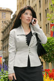 Meeting in the city. Careerwoman on way to a meeting, office, client Royalty Free Stock Images