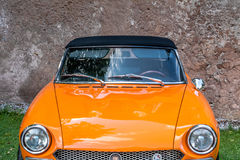 meeting of classic cars. Front closeup on the old orange car Stock Images