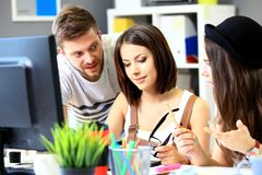 Meeting of co-workers and planning next steps of work. In office Stock Image