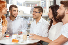 Meeting of colleagues after work. In cafe Royalty Free Stock Photo