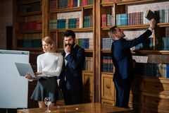 Meeting concept. University students have important meeting in library. Group of people in meeting room. Great business. Meeting and discussion. Developing royalty free stock image