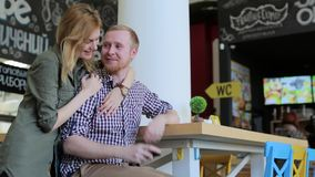 Meeting couples in love in the cafe. A chance meeting a couple in love in cafe stock video