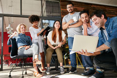Meeting of creative professional in modern office stock image