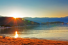 The meeting dawn on the beach in Budva Stock Photography
