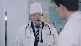 Meeting and discussing of two doctors in the hospital. 4K.  stock video