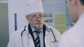 Meeting and discussing of two doctors in the hospital. 4K.  stock footage