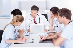 Meeting of doctors. Group Of Doctors Having Meeting In A Hospital royalty free stock photo