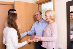 Meeting at the door Stock Images