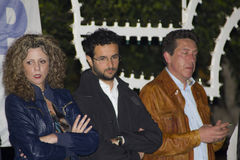 Meeting elected 5 stars lezzi, buccarella. Barbara lezzi, with emanuele scagliusi and buccarella on stage in a a meeting no tap at melendugno royalty free stock photos