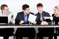 Meeting of entrepreneurs. Four entrepreneurs are sitting at the table Stock Images