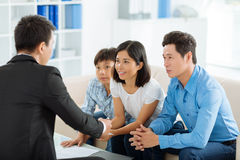 Meeting estate agent. Asian family meeting real estate agent in the office Royalty Free Stock Photo