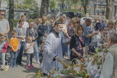 Meeting the faithful in front of the church to sacrifice food stock photos