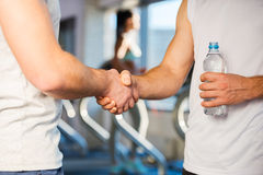 Meeting friend in gym. Royalty Free Stock Photo