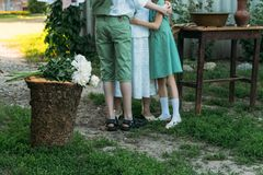 Meeting grandmother and grandchildren. grandmother embraces grandchildren, brother and sister. grandson and granddaughter came to. Visit. give flowers stock photo