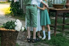 Meeting grandmother and grandchildren. grandmother embraces grandchildren, brother and sister. grandson and granddaughter came to. Visit. give flowers royalty free stock image