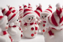 Meeting of a group of little snowmen. Meeting of a group of little snowmen talking about christmas Royalty Free Stock Image