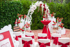 Meeting guests at the wedding - an arch, chairs, flowers, decorations. Stock Images
