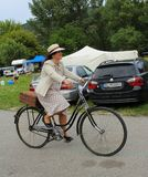 Meeting of Historical Bicycles - a lady in a vintage costume with corresponding bike. Meeting of Historical Bicycles in Devín village, Slovakia, central Europe Royalty Free Stock Photography
