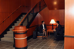 Meeting in Lobby Stock Images